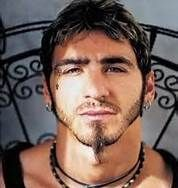 Sully Erna of Godsmack. Sings, drums, plays guitar. Excellent musician!