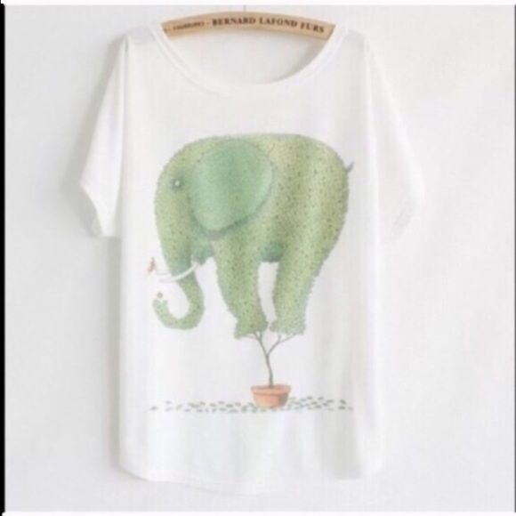"""1 HOUR SALEAnimal Print Tee New~Elephant~ Animal Print Tee New~Elephant  Style- Loose Batwing Sleeve Length 25.98"""" Bust 43""""-47"""" Soft and Comfy Fit Fabric: 65% Cotton 35% Polyester  Smoke FREE Home  No Tradefirm unless bundled Cute Tee Tops Tees - Short Sleeve"""