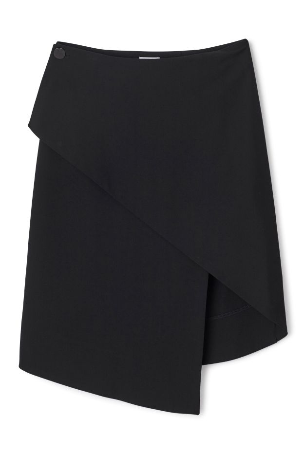The Solaris Skirt is an asymmetrical wrap skirt with an overlapping front and darts at the back for a flattering fit. - Size Small measures 73 cm in waist circumference and 63 cm in back length.