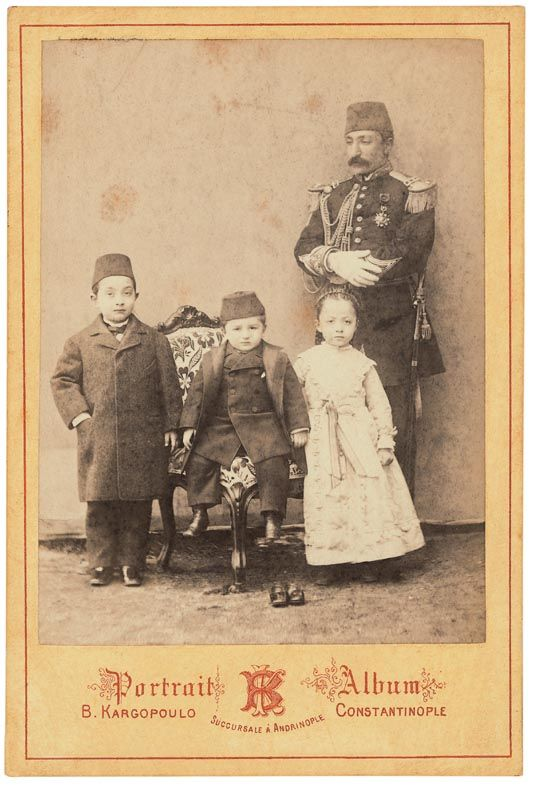 Two small princes and one 'sultane' (princess), and their 'lala' (educator).  Late 19th century.