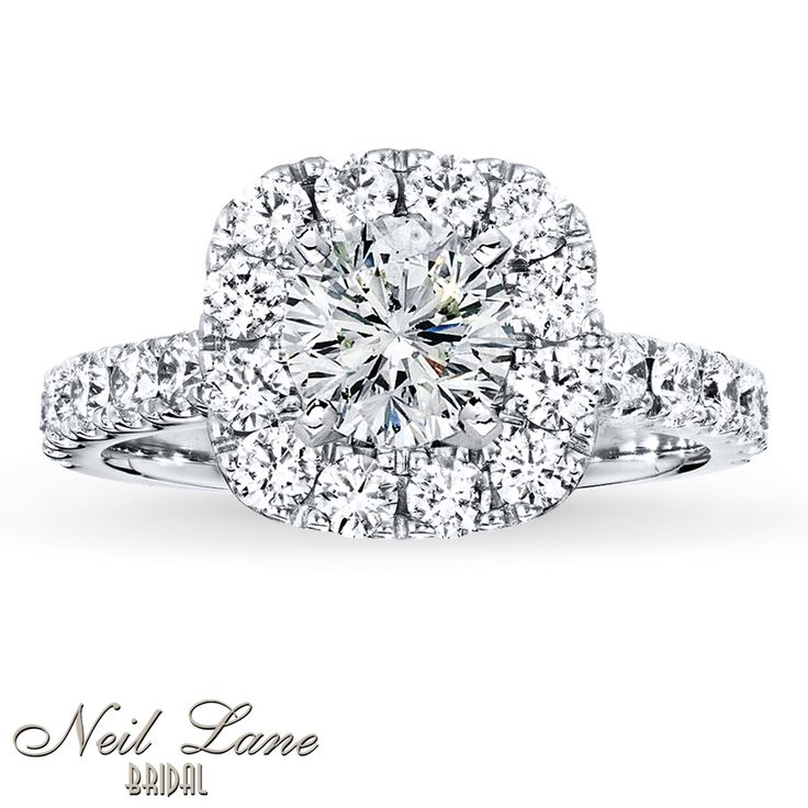 Round diamonds encircle the center and line the band of this exquisite engagement ring setting from the Neil Lane Bridal® collection. Additional diamonds edged in milgrain detail grace each profile to bring the total diamond weight to 1 1/6 carats. Fashioned in 14K white gold, the hand-crafted ring setting includes Neil Lane's signature inside the band, and undergoes a four-step polishing process which gives the ring its beautiful shine and luster. The center diamond is sold separately. ...