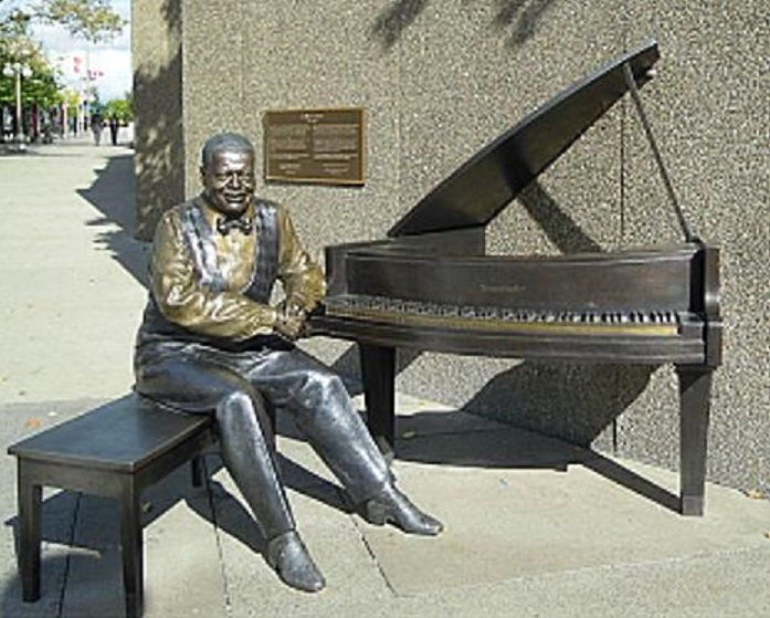 Statue in honor and dedicated to Oscar Peterson, great Canadian jazz pianist as it stands near the National Arts Centre in Ottawa Ont. Canada.
