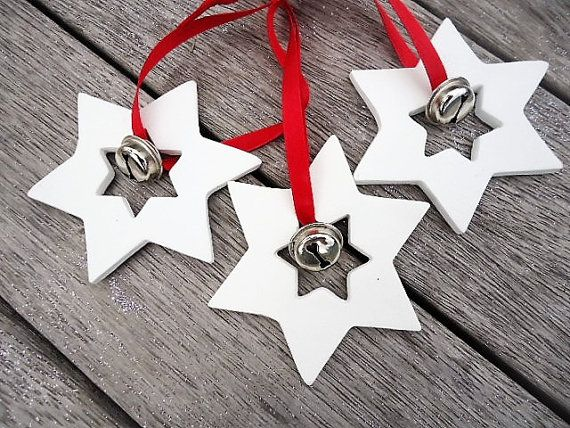 These gorgeous handmade Clay Star with Bell Ornaments are a great decoration for Christmas. You can hang it on your Christmas tree, in your window, use it as a gift tag, as table decoration or as a gift for someone special. These Star with Bell Ornaments are made out of Clay and carefully sanded to give it a beautiful finish. The listing is for 3 Star with Bells but you can choose the Quantity of more Ornaments. The Ribbon is approx. 13,5 cm long and the Star measures approx. 8 x 8 cm…