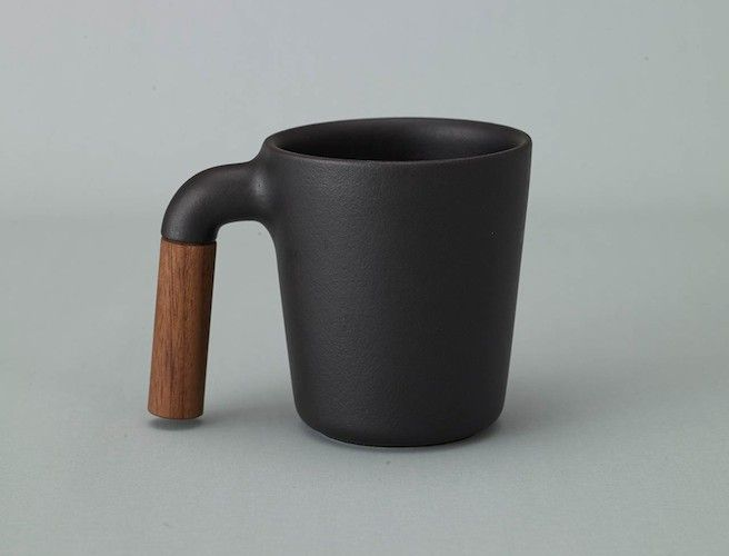By merging wood and ceramic in an artistic way, Mugr has transformed your standard mug into a classic showpiece. The mug is a very simple design and has no