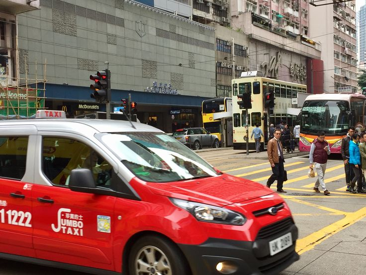 """Bill ✔️ Public Transport in Hong Kong. The new """"Maxi Taxi"""" - a Ford vehicle being introduced, often for mobility-challenged travellers; a Double Decker bus, a Double Decker Tram, and a tour coach.  This image taken on Hennessy Road, Wan Chai, Hong Kong Island, Hong Kong , China.      Bill Gibson-Patmore.  (iPhone image, curation & caption: @BillGP). Bill ✔️."""