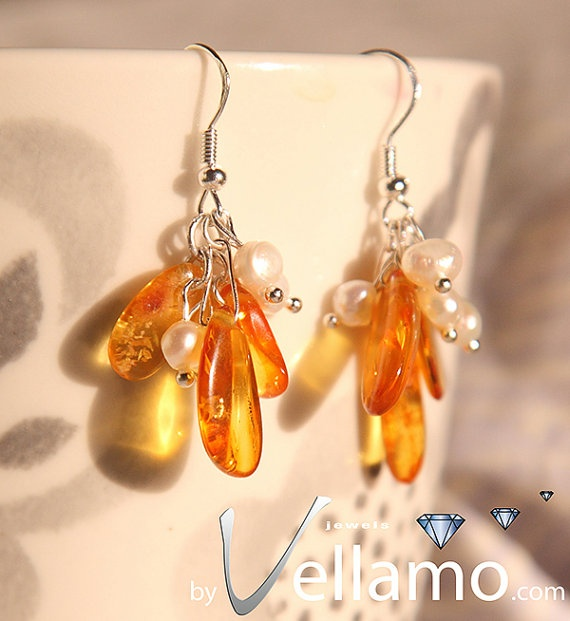 These are by Vellamo, very elegant, great colour amber, work very well with the pearls!