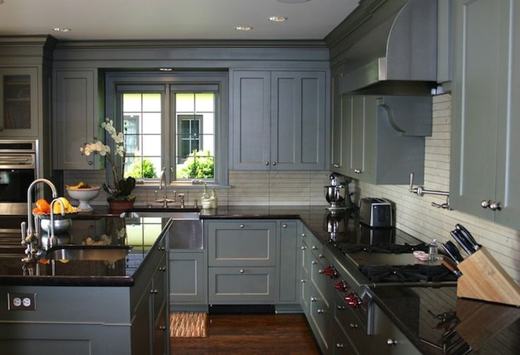 Gray cabinets, dark floor. I love that the cabinets go to the ceiling, but I think the space would look better with a white granite countertop.