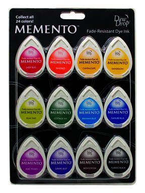 """Gum Drops"" Memento Dew Drop 12 piece set contains one each of the following Memento colors: Lady Bug (300), Tangelo (200), Cantaloupe (103), Dandelion (100), Pear Tart (703), Cottage Ivy (701), Bahama Blue (601), Danube Blue (600), Lilac Posies (501), Grape Jelly (500), Rich Cocoa (800), Tuxedo Black (900).  Memento Dew Drop - 12 piece set  Gum Drops  MD-012-100  $27.60 each"