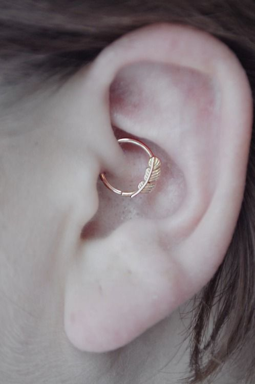 Daith piercing with metal feather ring. on The Fashion Time http://thefashiontime.com/5-cute-fun-ear-piercing-ideas/#sg40