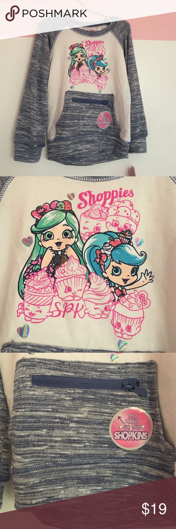 Shopkins Shoppies Longsleeve This is the cutest Shopkins Shoppies longsleeve shirt! It even features a zippered pocket in the front to hold your Shopkins! My daughter received it for Christmas but it's too small & we're unable to exchange it. Perfect for the little Shopkins collector in your life! Size 4/5T. Shirts & Tops Tees - Long Sleeve