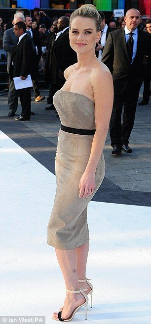 Alice Eve at Star Trek Into Darkness premiere in London.. wearing a Ermanno Scervino suede strapless dress with belt... complete with tight bun, and smokey eyes.