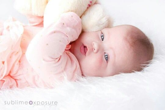 Baby smiles newborn photographer 5 month old girl