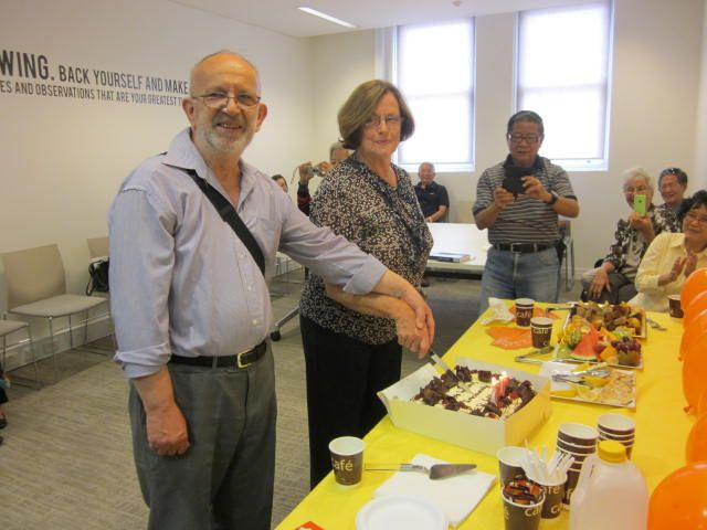 Cutting the cake for 75th Anniversary of the Library Act