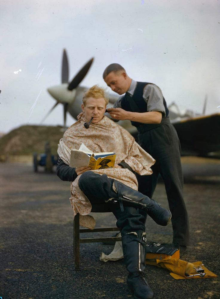 RAF pilot getting a haircut while reading a book between missions (colorized)