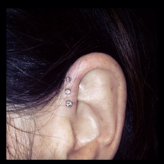 Triple forward / front helix piercing.  kind of want to get this...ouch