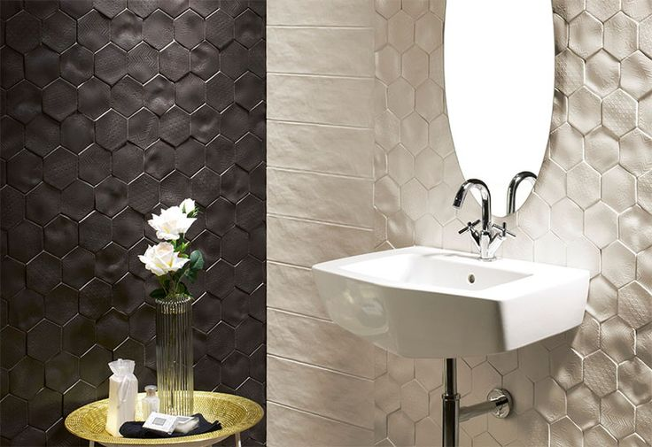 Bathroom Tile Idea - Install 3D Tiles To Add Texture To Your Bathroom | These tiles have different patterns imprinted on their uneven surfaces to create texture in two ways, and add a sophisticated contrast between black and white to the space.