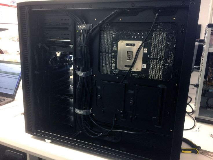 The wiring of the custom editing computer build in a Fractal Design R5 Blackout chassis.