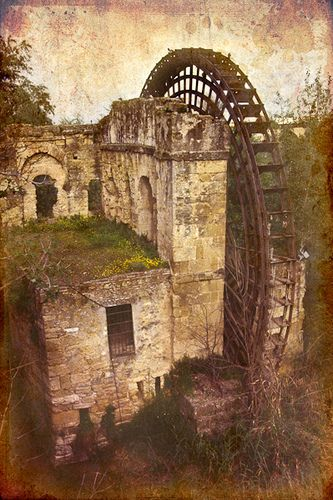 Water Wheel. Cordoba, Spain...Looks so spooky & cool