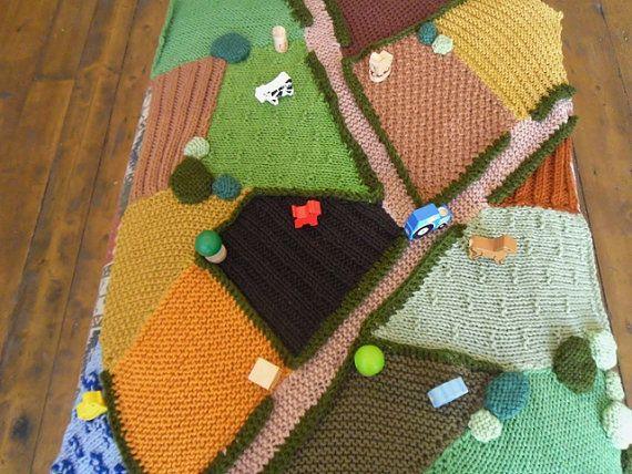 Hand Knitted Farm Rug. I like that its asymmetrical.