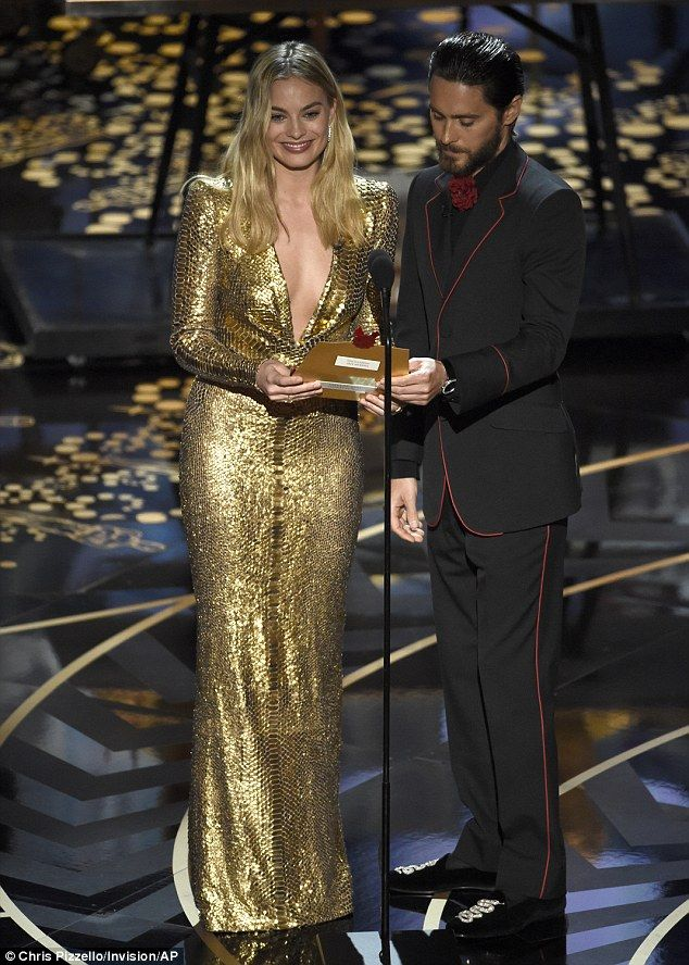 On stage: During the awards ceremony, Margot took to the stage with Jared Leto...