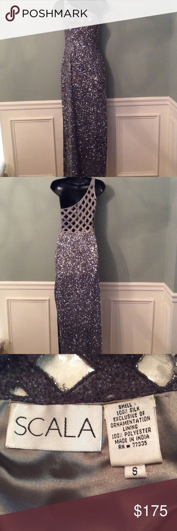 Scala sequin dress in silver Scala silver sequin dress, side zipper with clasp. This dress has 28 inch slits on each side.  One shoulder and gorgeous diamond patterned back.  Built in bra. Missing a few sequins here and there.  Length is 48 inches and the waist is 13 inches across.  Great for a prom or to attend a wedding. This dress will make you look like a star! Scala Dresses One Shoulder