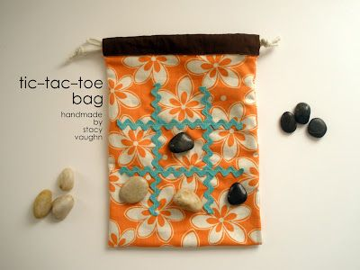 Tic-tac-toe bag; play a game then toss the pieces inside to store. Could work for travel checkers, too...