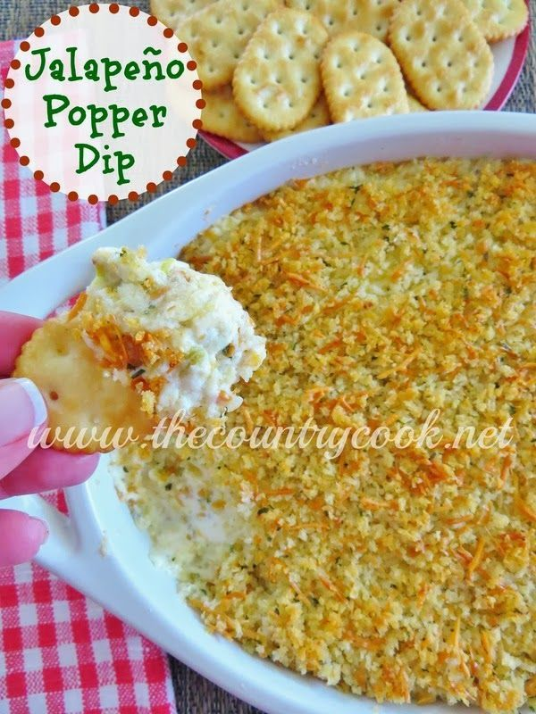 Jalapeño Popper Dip from The Country Cook. Layers of creamy cheese with diced jalapeños all topped off with a panko crumb topping - can't stop eating it!