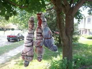 "Going to fill the ""body bags"" with the leaves in our yard & maybe some old clothes/old shoes :) splatter the tarp/bag in blood"