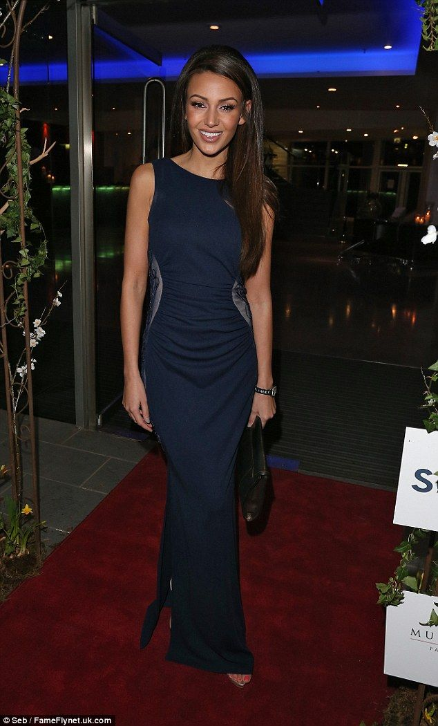 Picture perfect: Michelle was centre of attention at the fundraising ball as she took to t...