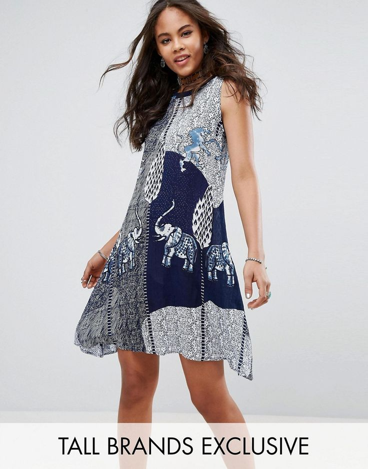 Buy it now. Glamorous Tall Swing Dress In Aztec Elephant Print - Navy. Tall dress by Glamorous Tall, Woven fabric, Boat neck, Curved hem, Relaxed fit, Machine wash, 100% Viscose, Our model wears a UK 8/EU 36/US 4 and is 180cm/5'11 tall, Exclusive to ASOS. ABOUT GLAMOROUS TALL Glamorous pulls together an eclectic mix of vintage influences and brand new trends. Glamorous Tall brings us the same fashion-led pieces as their mainline collection � day-to-night swing dresses, printed maxis and…