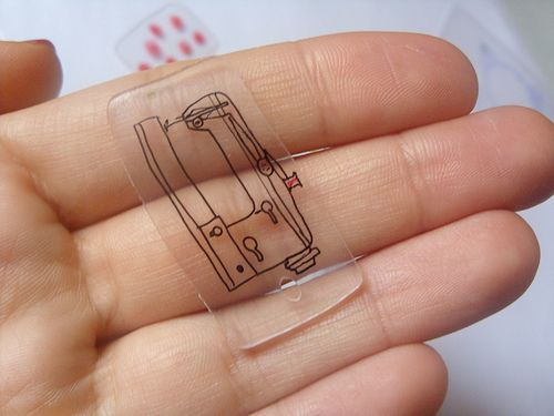 in Germany used plastic no 6 is also usable as shrinking foil:   cut out plastic - it shrinks to 1/3 bake it at 140 ° in the pre-heated oven watch it meanwhile until it has the wanted size - or until it is flat again stamp or draw with water resistant ink