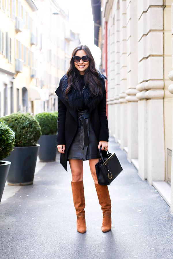 Black coat with brown boots.