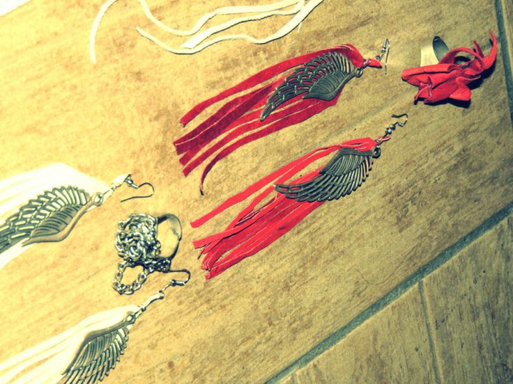 Handmade leather earrings with feathers.