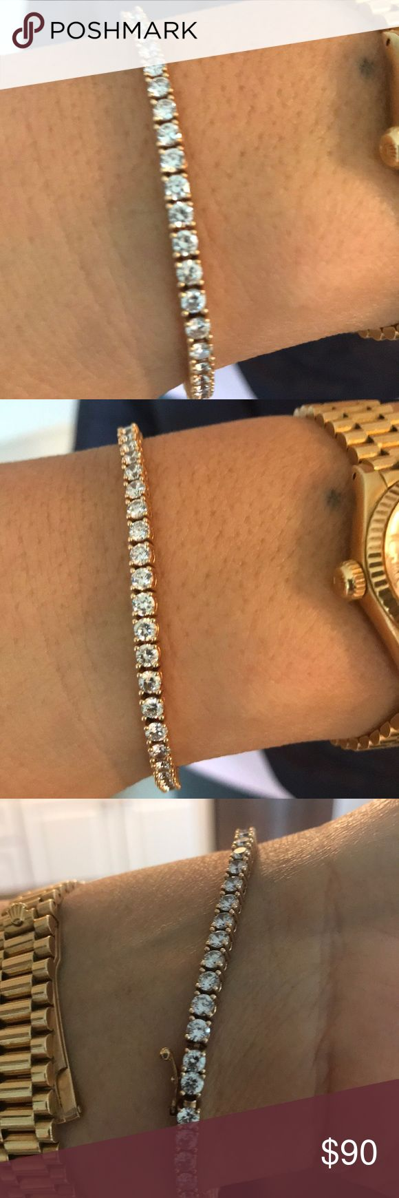 Set in gold gorgeous CZ BRACELET From SAKS FIFTH AVE THIS GORGEOUS TENNIS BRACELET IS A PERFECT PIECE FOR THE HOLIDAYS. Retails for 250 but not here in my closet . You don't need the real deal if your CZ's are good quality! Saks Fifth Avenue Jewelry Bracelets