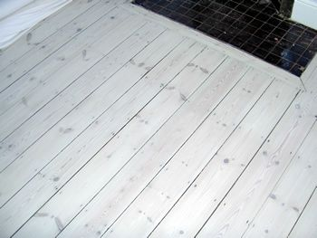 OMG -- even crazier -- what about a combination of tile and white wooden floor boards??!!