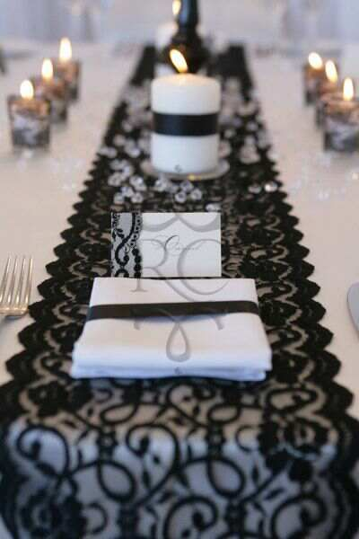 white tables, black runner (crinkle fabric?)