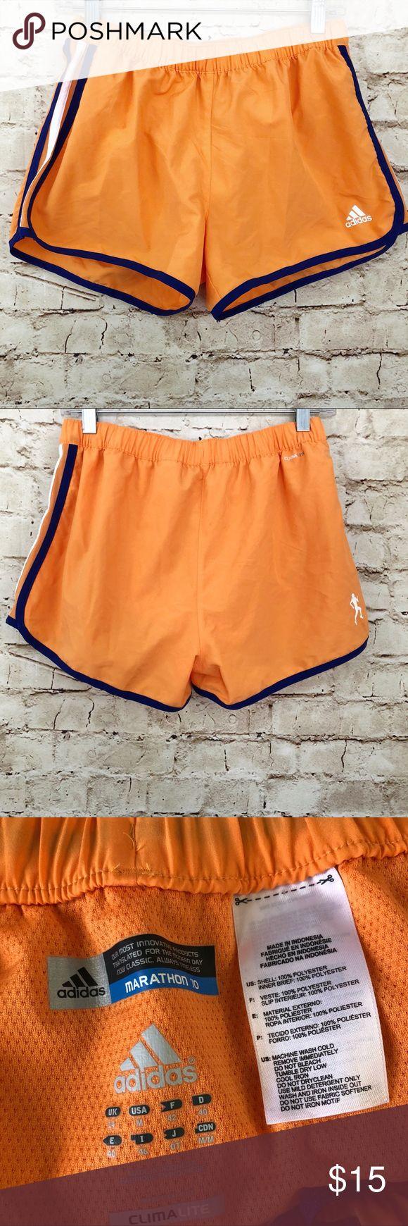 "Adidas marathon 10 running shorts climalite Adidas Marathon 10 climlite running shorts  Women's size medium  Orange navy & white  11"" long from waist  14"" waist flat lay (elastic stretch) adidas Shorts"