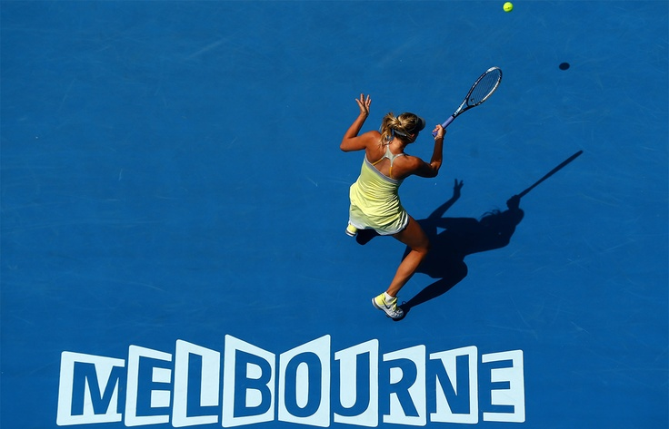 Maria Sharapova hits a forehand in front of Melbourne signage during her straight sets win over Olga Puchkova during the first round.  Australian Open Tennis 2013  #tennis  #ausopen  #sharapova  @Tourism Victoria