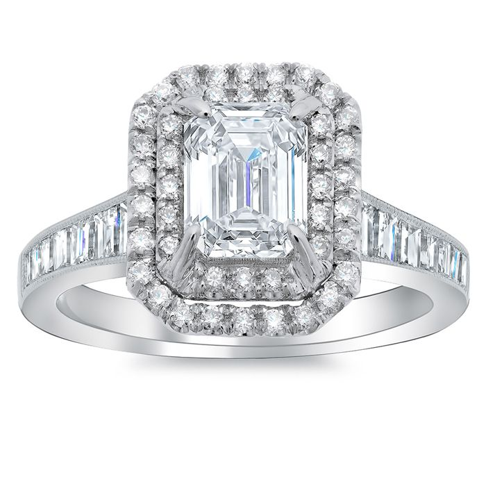 This double halo engagement ring incorporates channel set baguettes beautifully allowing them to be an excellent compliment to an emerald cut diamond.