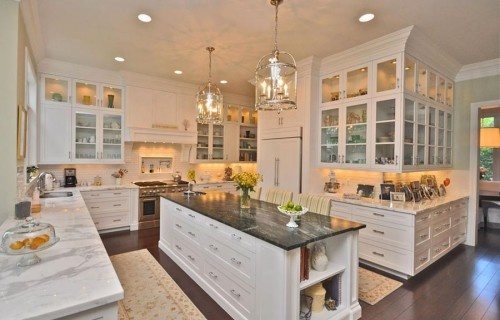 Stunning white cabinetry in this amazing kitchen! I do like this, but still needing an oversize wood island/ eating bar! The lights are nice, and Im a fan of that glass front cabinets all over, I have a lot of china and dishes to display!