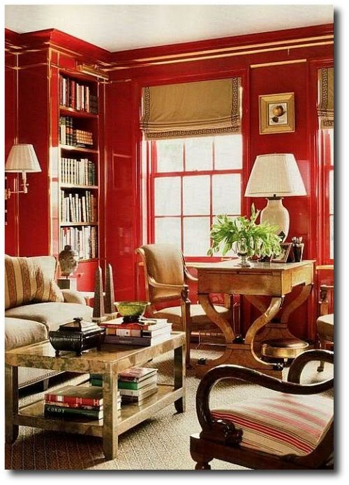 fun takeoff on Albert Hadley's library with red lacquered walls and brass trim - Nancy Bozshardt design.
