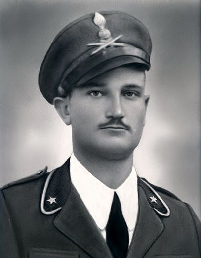Giuseppe Torcasio in uniform with the corps heavy artillery regiment insignia on his peaked visor cap,During World War II in Tripoli,North Africa 1942