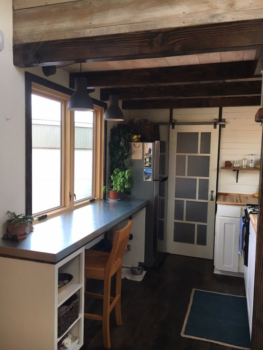 The Tanler Tiny House,a tiny home on wheels designed by its owners Hannah and Corey for a mere $18,000.