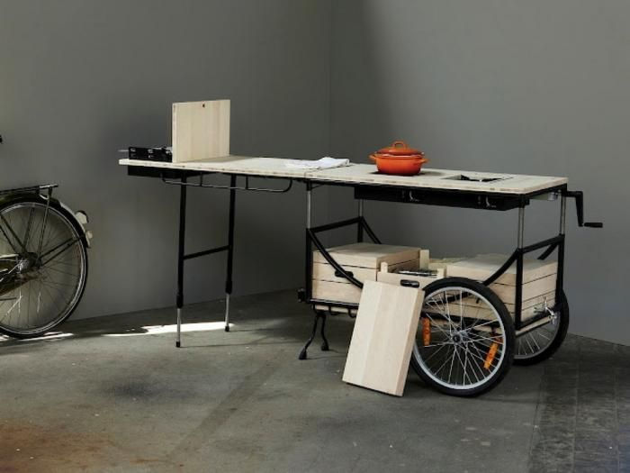 The Bicycle Stove features two gas hobs, a work surface, and a barbecue facility.