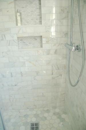 All same tile, Calcutta hex on floor, subway on walls, mini bricks in niche... by delia