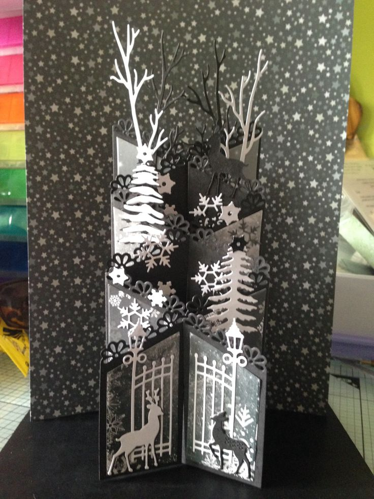 Made by Nicola Wootton - As soon as i saw the coture winter scene dies on air I had this card in mind to use with the Tattered lace zigzag die as a base. Decided it to keep it monotone and use the backing papers that came with the couture die set.
