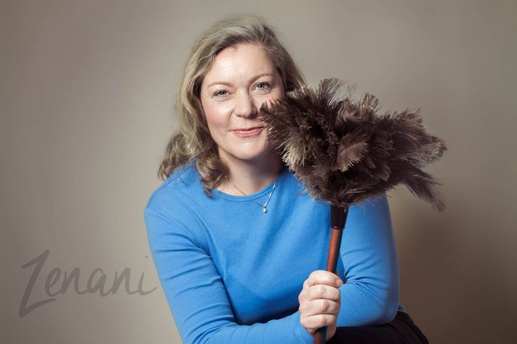 Portrait of a business woman with a broom in her hand - online communication specialist
