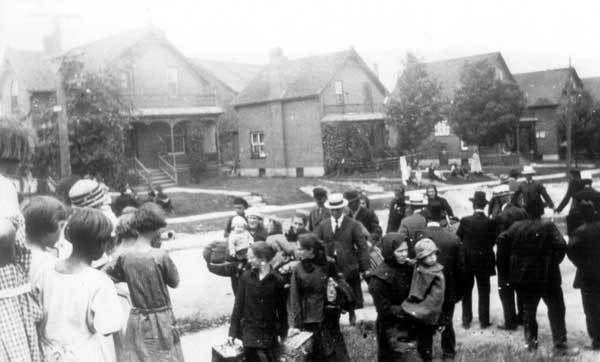 Mennonite immigrants from the Soviet Union approaching Erb Street Mennonite Church, July, 1924. (Canada). Mennonite communities left the USSR in large numbers as a result of the hostility against them; 13000 fled in 1928