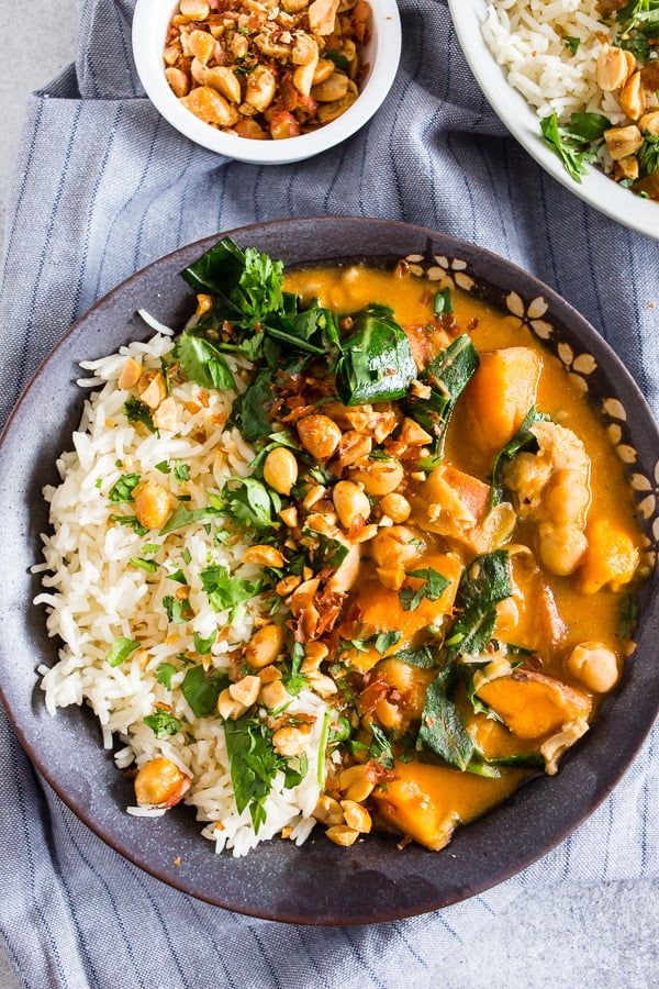 This African chicken peanut stew is packed full of chicken thighs, sweet potatoes, chickpeas, and collard greens simmering in a flavorful peanut butter and chicken stock broth. It's deliciously spicy