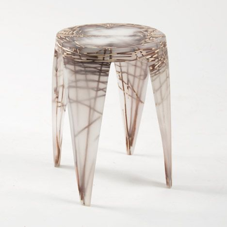 Patterns of woven natural fibres emerge from this milky resin furniture by Design Academy Eindhoven graduate Wiktoria Szawiel.